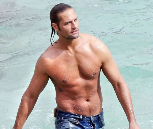 Josh Holloway has fun with water