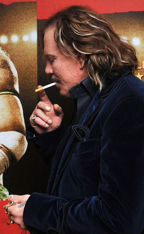 Mickey Rourke smokes