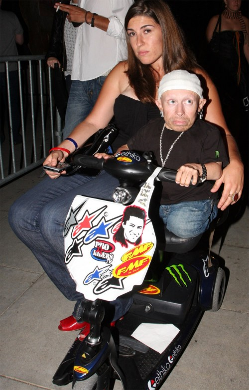 Verne Troyer rides his scooter