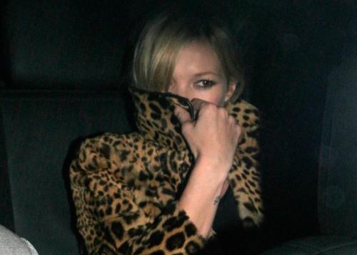 Kate Moss pretends to be a ninja