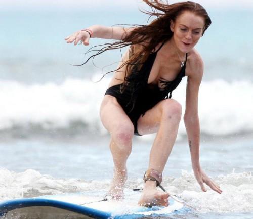 lindsay lohan surfs