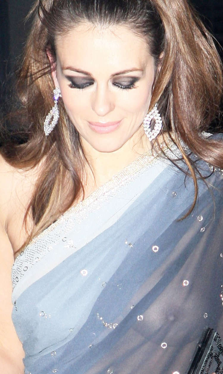 Elizabeth hurley see through dress was and