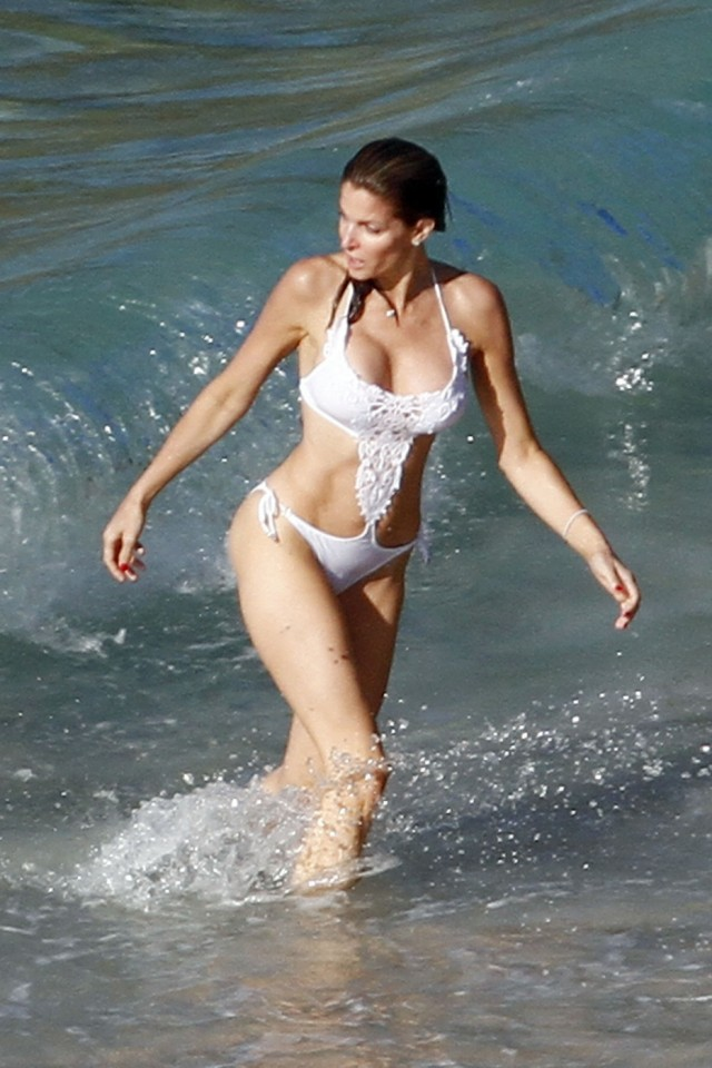 Stephanie Seymour frolicks on the beach in Saint Barthelemy wearing a skimpy white bathing suit