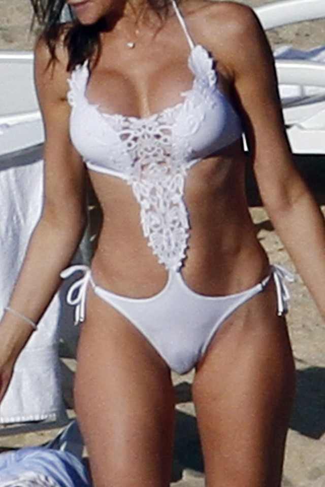 **EXPLICIT CONTENT** Stephanie Seymour frolicks on the beach in Saint Barthelemy wearing a reavealing white bathing suit