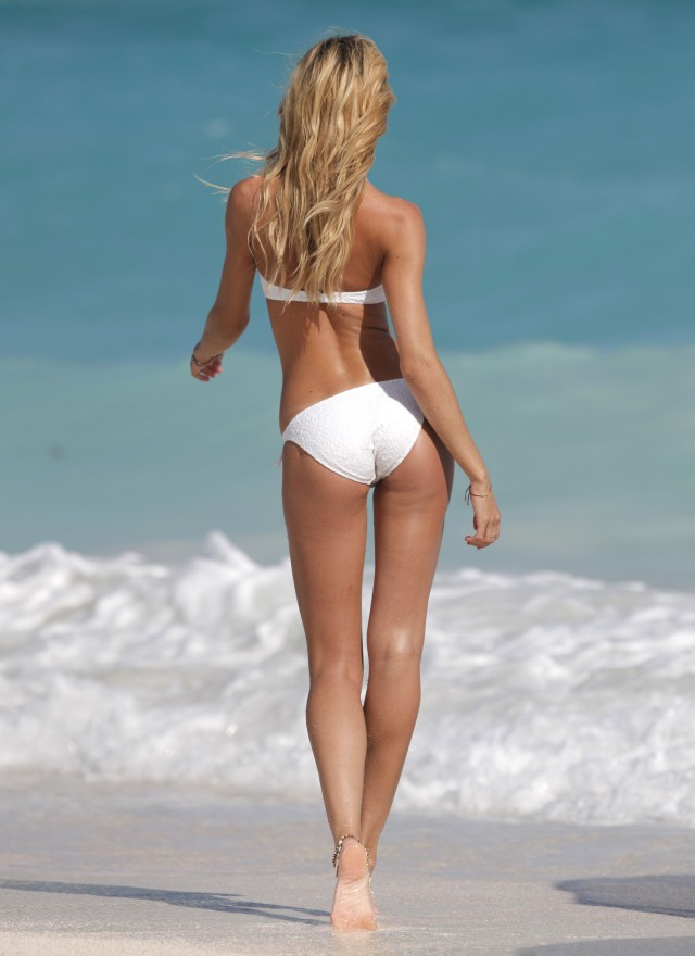 Candice Swanepoel Hits The Beach For Victoria Secret