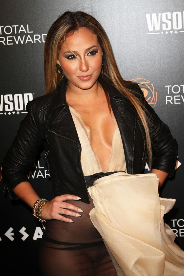 ** WARNING: Contains Nudity ** Adrienne Bailon has a wardrobe malfunction at The 'Escape To Total Awards Event' in NYC