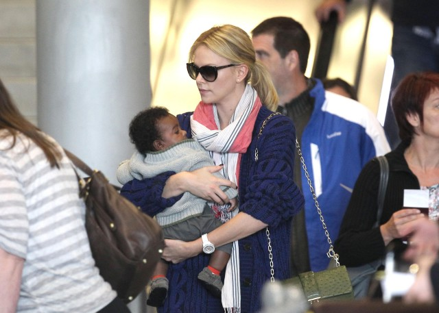 Charlize Theron And Baby Jackson Land In Paris