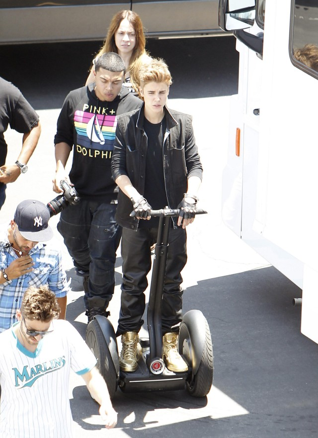 Justin Bieber Keeps His Gold Sneakers Clean Driving a Segway