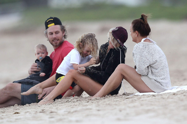 The Simpson Clan Enjoying A Day On The Beach