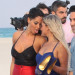 French Reality star Nabilla Benattia holding hands and sticking her tongue to a female cast member on the beach in Miami Beach