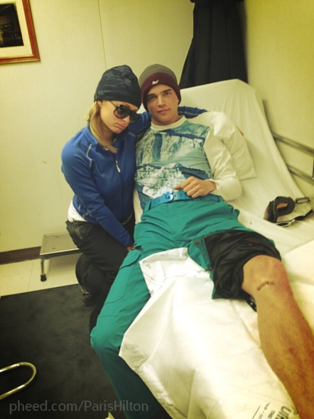 Paris Hilton Poses in Front of Injured Boyfriend