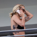 British singer Rita Ora in a black bikini on a balcony in Miami
