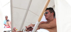 Simon Cowell Gets A Ticket On The Beach