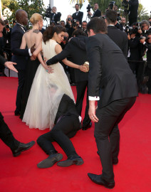 Vitalii Sediuk Sneaks Under America Ferrera's Dress At Cannes Premiere!
