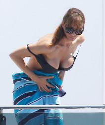 Jennifer Flavin Shows Some Skin In France