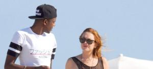 Lindsay Lohan Takes A Stroll On The Beach