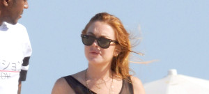 Lindsay Lohan Takes A Stroll On The Beach