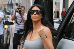 51771078 Pregnant reality star Kim Kardashian goes shopping in Beverly Hills, California on June 12, 2015. Kim left little to the imagination in her tight, form fitting grey dress. According to Us Weekly, Kim and Kayne West are expecting a boy this go around. FameFlynet, Inc - Beverly Hills, CA, USA - +1 (818) 307-4813