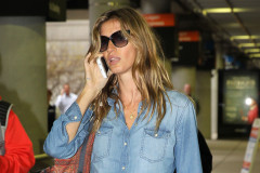 "51713290 After retiring from the catwalk after 20 years in the business, model Gisele Bundchen arrives on a flight at Logan Airport on April 17, 2015 in Boston, Massachusetts. Gisele, who walked the catwalk for the final time at Sao Paulo Fashion Week on Wednesday, reflected on her career with a post on Instagram. ""I am grateful that at 14, I was given the opportunity to start this journey. Today after 20 years in the industry, it is a privilege to be doing my last fashion show by choice and yet still be working in other facets of the business."" FameFlynet, Inc - Beverly Hills, CA, USA - +1 (818) 307-4813"