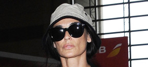 51787690 Actress Demi Moore departing on a flight at LAX airport in Los Angeles, California on July 1, 2015. The 52 year old mother of three was joined by a friend on her journey.  FameFlynet, Inc - Beverly Hills, CA, USA - +1 (818) 307-4813
