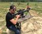 Kid Rock shooting a gun