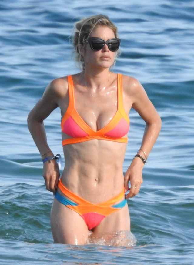 51804987 Supermodel Doutzen Kroes is seen enjoying the sun with husband Sunnery James in Spain on July 21, 2015. The former Victoria's Secret model showed off her toned figure in a brightly colored bikini while she and her husband of five years posed for pictures together. FameFlynet, Inc - Beverly Hills, CA, USA - +1 (818) 307-4813 RESTRICTIONS APPLY: USA ONLY