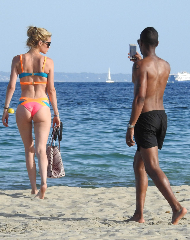 51805002 Supermodel Doutzen Kroes is seen enjoying the sun with husband Sunnery James in Spain on July 21, 2015. The former Victoria's Secret model showed off her toned figure in a brightly colored bikini while she and her husband of five years posed for pictures together. FameFlynet, Inc - Beverly Hills, CA, USA - +1 (818) 307-4813 RESTRICTIONS APPLY: USA ONLY