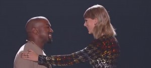 Taylor swift towers over kanye west