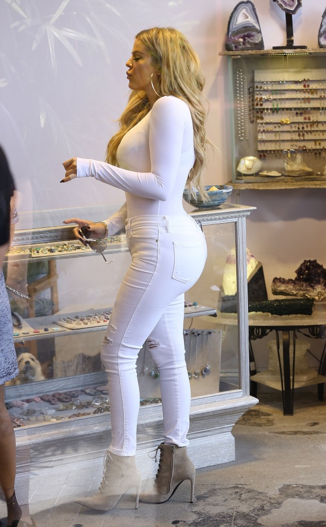51838740 Reality star Khloe Kardashian is spotted shopping at a store for fine gems and stones in West Hollywood, California while a camera crew films her every move on September 1, 2015.  The 31-year-old 'Keeping Up With The Kardashians' star showed off her curvy figure in some tight white pants. FameFlynet, Inc - Beverly Hills, CA, USA - +1 (818) 307-4813