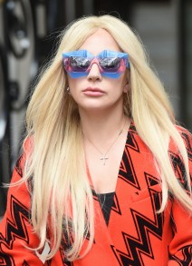 51917486 Singer Lady Gaga leaves the Langham Hotel in London, England on November 25, 2015. The 'Poker Face' singer showed off her eccentric fashion sense in a knee-length orange coat with a zig-zag pattern, sheer black stockings, platform black shoes and black leather gloves. FameFlynet, Inc - Beverly Hills, CA, USA - +1 (818) 307-4813 RESTRICTIONS APPLY: USA/CHINA ONLY