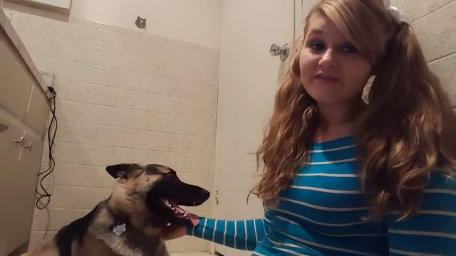 Teen girl having sex with dog