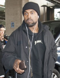 51974082 Rapper Kanye West is seen arriving on a flight at Charles de Gaulle Airport in Paris, France on February 18, 2016. The troubled star recently revealed on Twitter that he is $53 million in debt. FameFlynet, Inc - Beverly Hills, CA, USA - +1 (310) 505-9876 RESTRICTIONS APPLY: USA ONLY