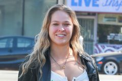 52004322 MMA fighter Ronda Rousey was spotted grabbing some coffee from Starbucks on March 24, 2016.  Before getting something to drink, two police officers stopped to ask her for a photo.  Ronda's mom talked in an interview about how Ronda's great grandfather was one of the first African Americans to be a physician in North America.  (TMZ) FameFlynet, Inc - Beverly Hills, CA, USA - +1 (310) 505-9876