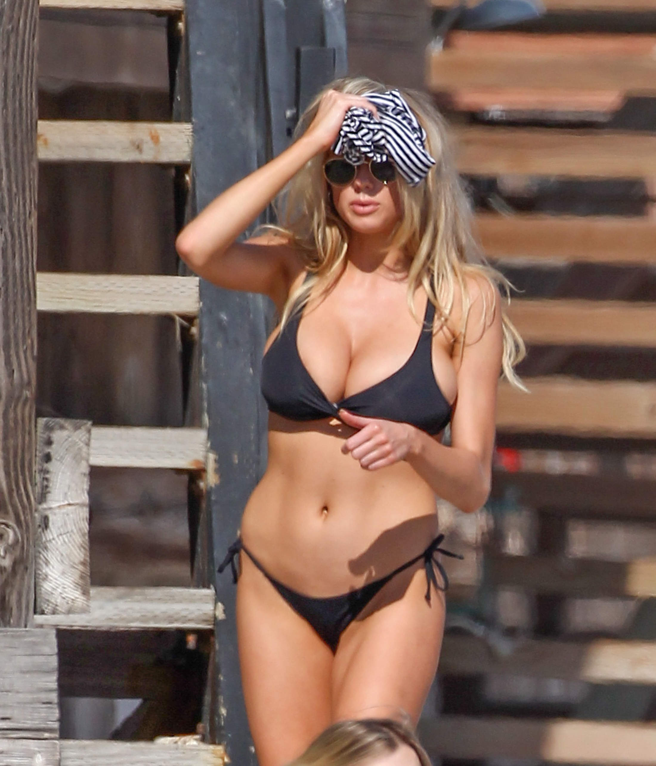 52097274 Actress and model Charlotte McKinney shows off her bikini body in Malibu, California on June 18, 2016.  At one point, she took off her tank top to work on her tan. FameFlynet, Inc - Beverly Hills, CA, USA - +1 (310) 505-9876