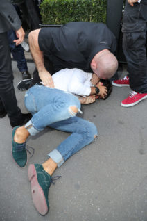 52188124 Ukrainian journalist Vitalii Sediuk is seen attepmting to kiss reality star Kim Kardashian's butt while at the Avenue restaurant in Paris, France on September 28, 2016. Vitalii quickly regretted this decision as he was immediately tackled to the ground by Kim's massive bodyguards! Vitalii also recently made headlines after grabbing Gigi Hadid outside the Max Mara fashion show in Milan. FameFlynet, Inc - Beverly Hills, CA, USA - +1 (310) 505-9876 RESTRICTIONS APPLY: USA ONLY