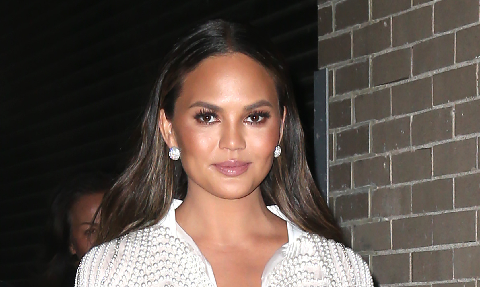 Chrissy Teigen Schools A Twitter Troll After He Calls John Legend