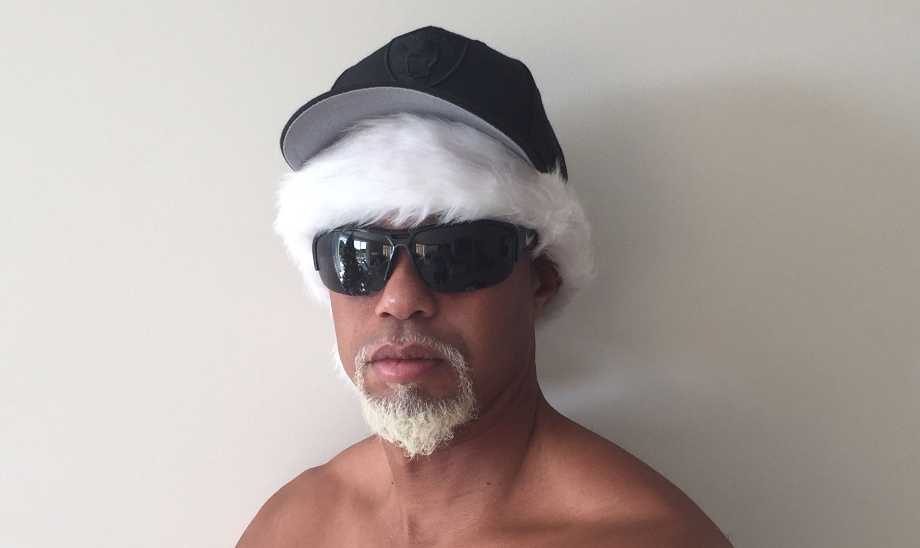 Tiger Woods posted a freaky shirtless photo calling himself 'Mac Daddy Santa'