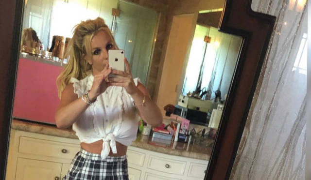 "Music Britney Spears Still Looks Amazing in That '… Baby One More Time"" Outfit"